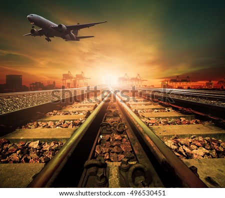 track of railway and cargo plane flying above logistic ship port background for transportation business