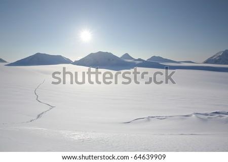 Track on the snow - winter Arctic landscape