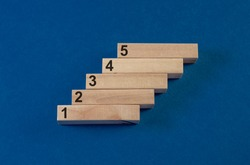 track start: 1,2,3,4,5 steps or stairs of wood on dark blue background