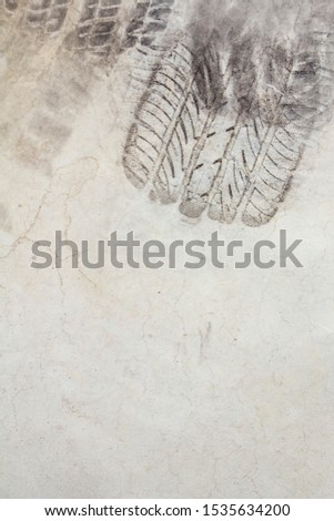 Track tire on cement or asphalt for background, Dark tone #1535634200