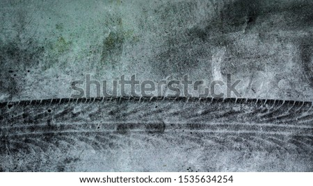 Track tire on cement or asphalt for background, Dark tone #1535634254