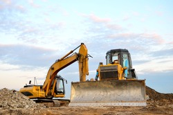 Track-type bulldozer, earth-moving equipment. Land clearing, grading, pool excavation, utility trenching, utility trenching and foundation digging during of large construction jobs.