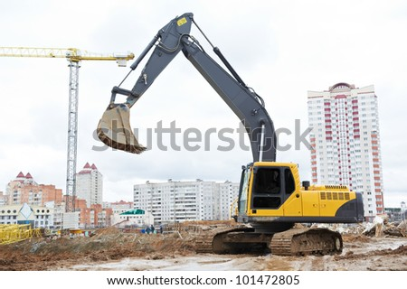track-type loader excavator machine doing earthmoving work at sand quarry in construction building area