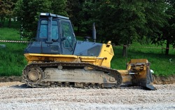 Tracked dozer on the gravel surface (substrate prepared for an asphalt road)