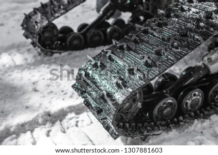 Tracked quad wheel. Winter transport. Cross-country vehicles. Rubber chain. ATV protector. Military car. All-terrain vehicle. Riding off-road. #1307881603