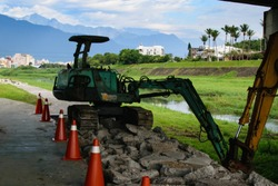 Trackhoe Digging Up Land For New Trail Construction