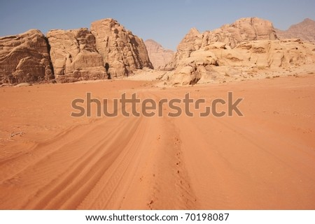 tracks leading to the mountains in wadi rum desert, Jordan