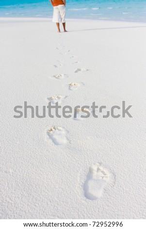 Tracks on sand of wonderful tropical beach