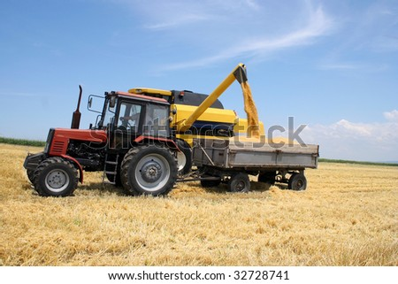 stock-photo-tractor-and-combine-harvested-wheat-32728741.jpg