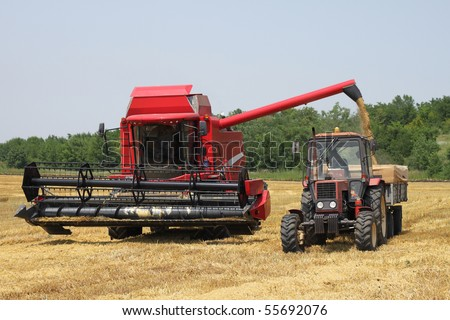 tractor and combine harvested wheat