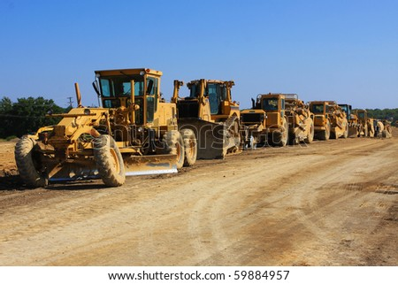 tractor convoy on a construction site