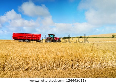 Tractor during harvest #1244420119