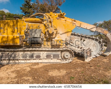 Tractor for digging trenches and ditches