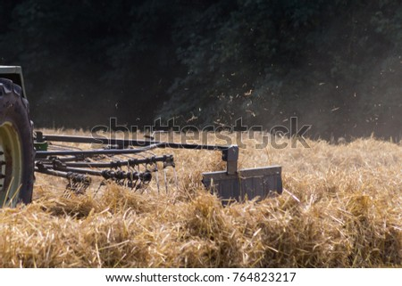 tractor haying straw on summer corn field in south germany countryside #764823217