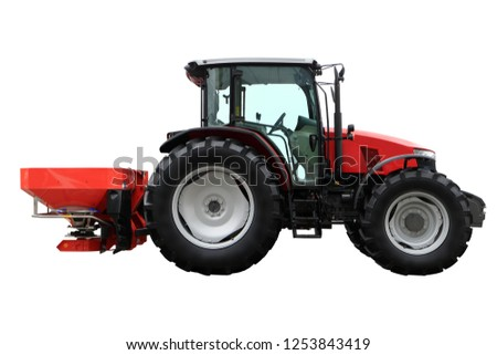 tractor image with attachments for application of fertilizers. #1253843419
