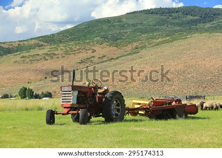 Tractor in a rural field, Utah, USA.