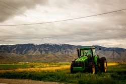 tractor in front of a mountain