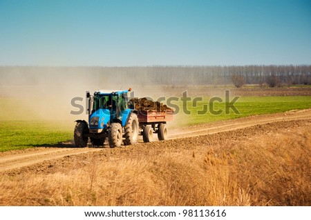Tractor in the field, agricultural season is starting