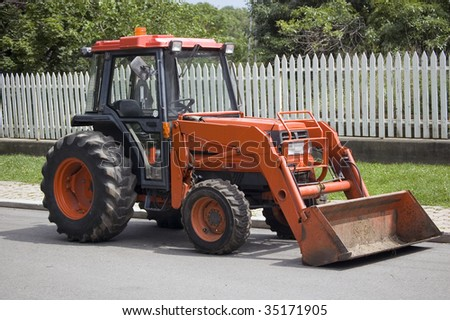 tractor in the summer rural community / construction machine