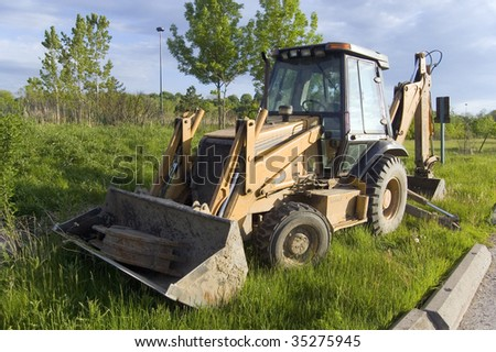 tractor on a summer field / construction machine
