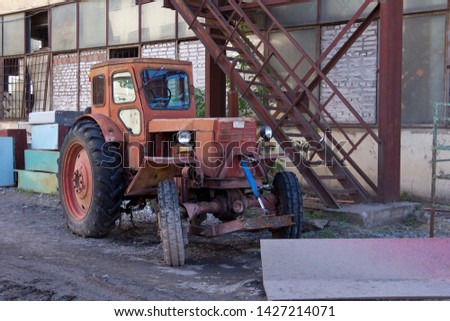 Tractor on the farm, a oid agricultural transport. Agricultural machinery.
