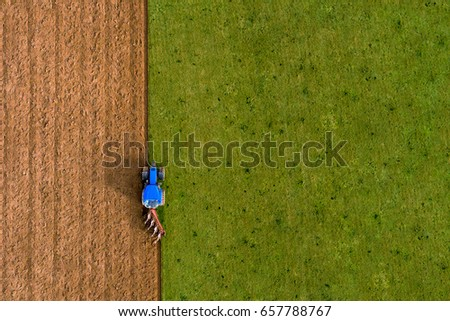Tractor Ploughing Field Vertical Left