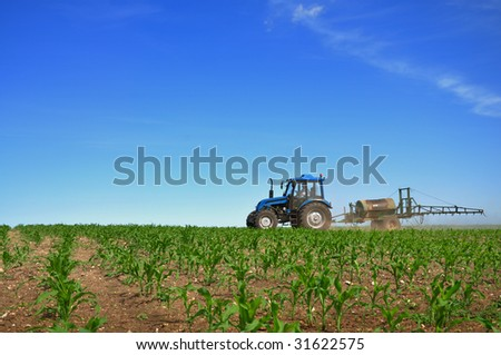 Tractor plowing the fields horizontal
