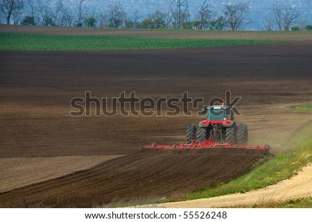 Tractor plowing the fields in the countryside