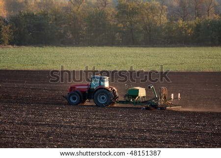 Tractor plowing the soil
