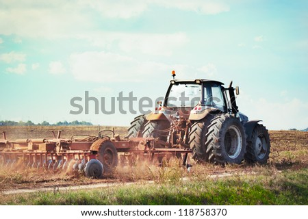 Tractor plowing the soil in autumn.