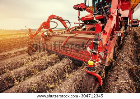 Tractor plowing up the field.