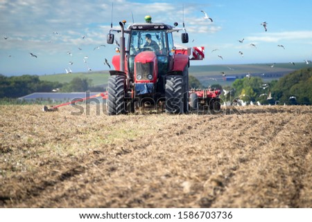 Tractor Pulling Drill Sowing Wheat Seed In Field