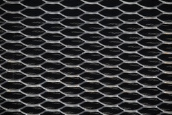 Tractor radiator grille for design and background. Abstract metallic mesh background.