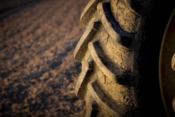 Tractor tire on field