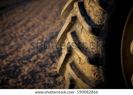 Tractor tire on field #590082866