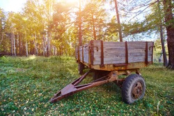 Tractor trailer. An old trailer sits on a green lawn.