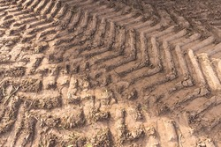 Tractor tyre (tire) tracks on the ground after agricultural works