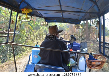 Tractor used for taking tourists to the top of the mountain called Phu Chom Lao along rough and tough road in a countryside of Thai Li District, Loei Province, where Lao PDR landscape can be seen #1289751664
