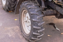 tractor wheel with suspension on asphalt.