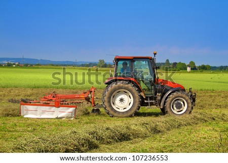 Tractor with rotary rakes