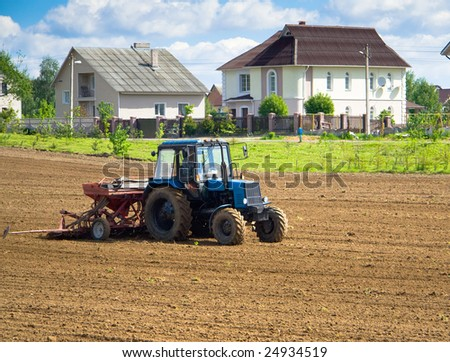 Tractor working in a country side field