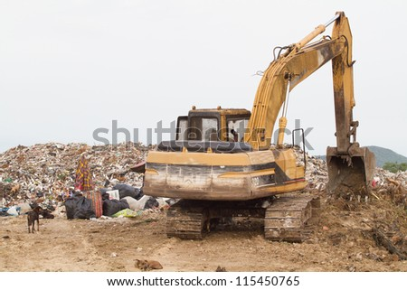 tractor working  the landfill