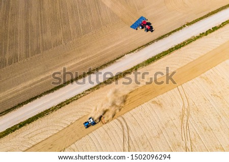 Tractors cultivate extremely dry soil in countryside. Farming problems. Cultivation concept #1502096294