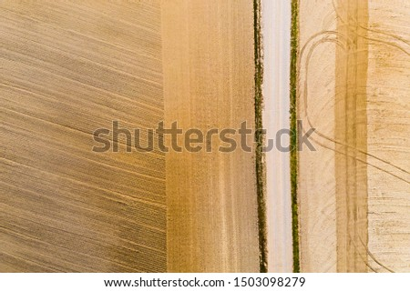 Tractors cultivated farmlands, aerial landscape. Dry soil concept. Track pattern #1503098279