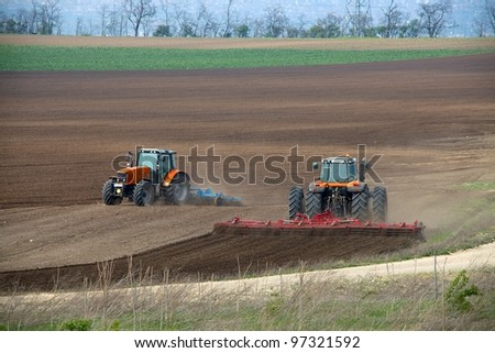 Tractors plowing the fields