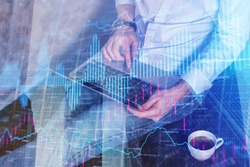 Trade and market concept. Hands using laptop with abstract forex chart on floor next to coffee cup. Double exposure