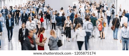 trade fair visitors walking in a clean futuristic corridor #1205875174
