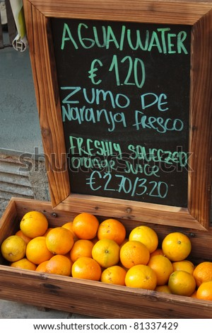 Trade orange juice in Barcelona and blackboard