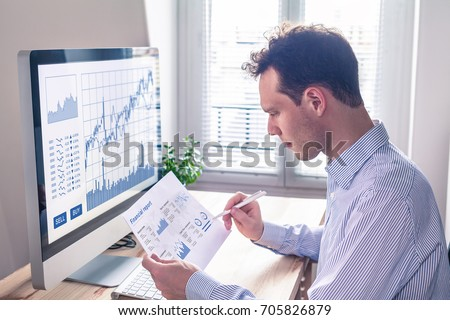Trader analyzing financial report and trading charts and computer screen for successful sell buy strategy of stock market investment, fintech concept
