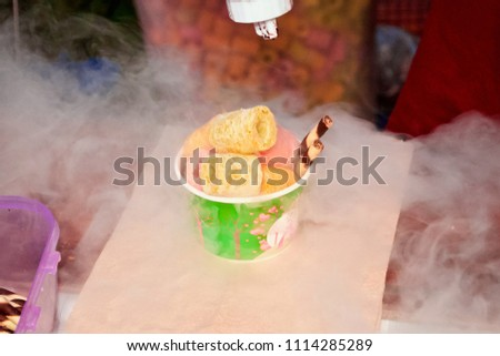 Trader in the market showing how to make the Dragon breath dessert or